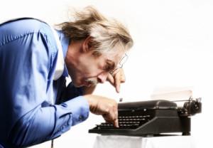 Businessman using a typewriter.
